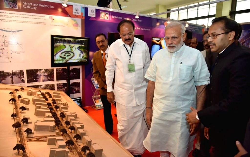 Prime Minister Narendra Modi visits the Smart Cities Exhibition, in Pune on June 25, 2016. Also seen the Union Minister for Urban Development, Housing and Urban Poverty Alleviation and ... - Narendra Modi and Venkaiah Naidu