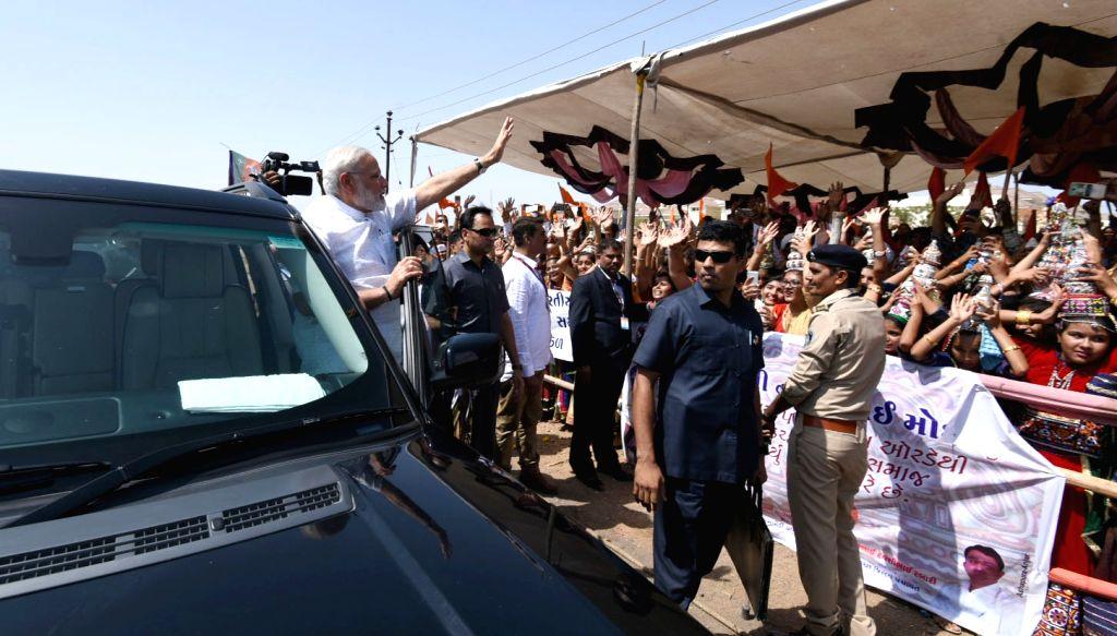 Prime Minister Narendra Modi waves at people in Bhuj of Gujarat's Kutch district on May 22, 2017. - Narendra Modi