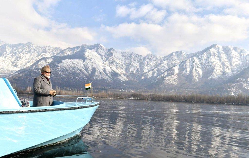 Prime Minister Narendra Modi waves at public while taking a boat ride in Srinagar's Dal Lake on Jan 3, 2019. - Narendra Modi