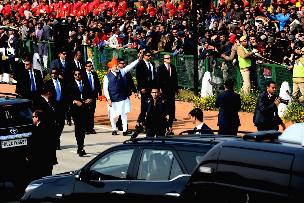 Prime Minister Narendra Modi waves at the audience before his departure after the curtains came down at the 71st Republic Day parade, at Rajpath in New Delhi on Jan 26, 2020. - Narendra Modi