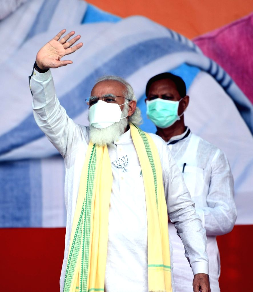 Prime Minister Narendra Modi waves at the crowd at a public meeting ahead of Bihar Assembly elections, in Sasaram on Oct 23, 2020. - Narendra Modi