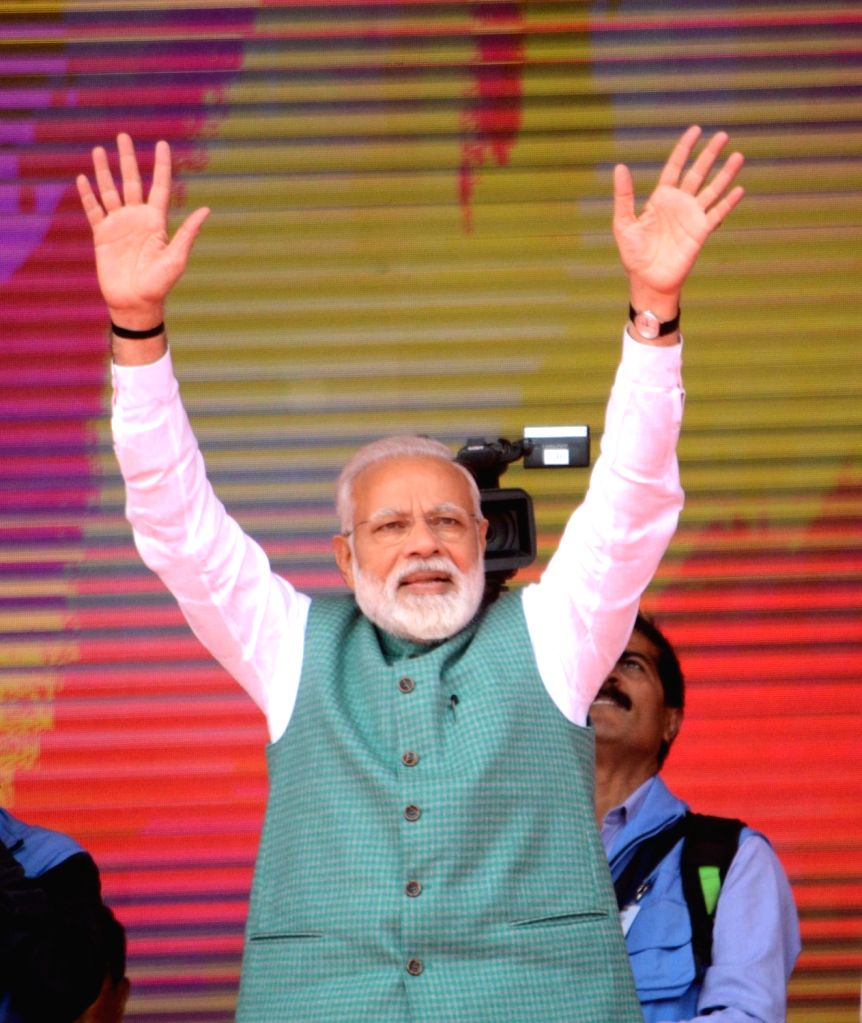 Prime Minister Narendra Modi waves to the crowd at 'Sankalp Rally' in Patna, on March 3, 2019. - Narendra Modi