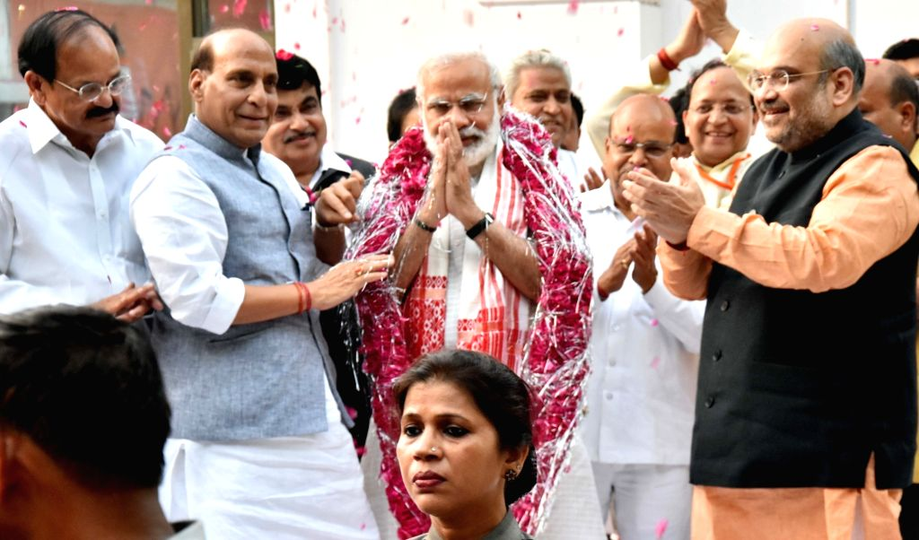 Prime Minister Narendra Modi wearing Japi -a traditional headgear of Assam- with Union Ministers Rajnath Singh, Nitin Gadkari, Venkaiah Naidu and BJP chief Amit Shah at BJP head office in ... - Narendra Modi, Ministers Rajnath Singh, Nitin Gadkari, Venkaiah Naidu, B and Amit Shah