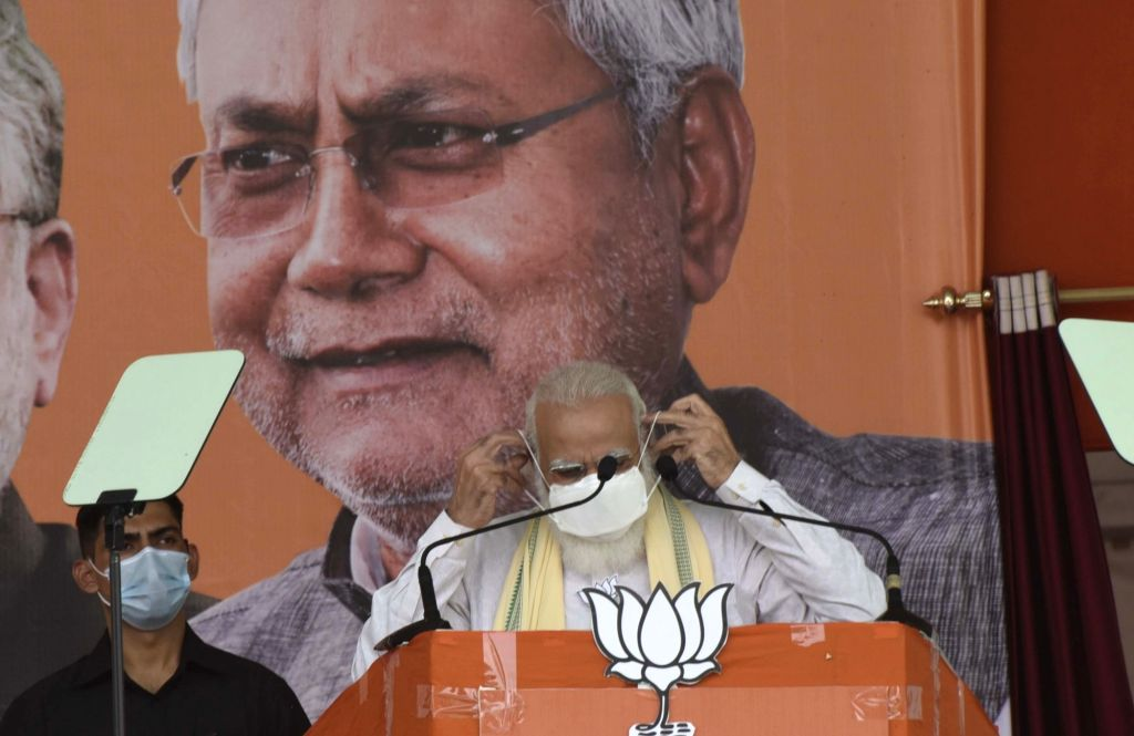 Prime Minister Narendra Modi wears a mask before starting his address at a public meeting ahead of Bihar Assembly elections, in Sasaram on Oct 23, 2020. - Narendra Modi