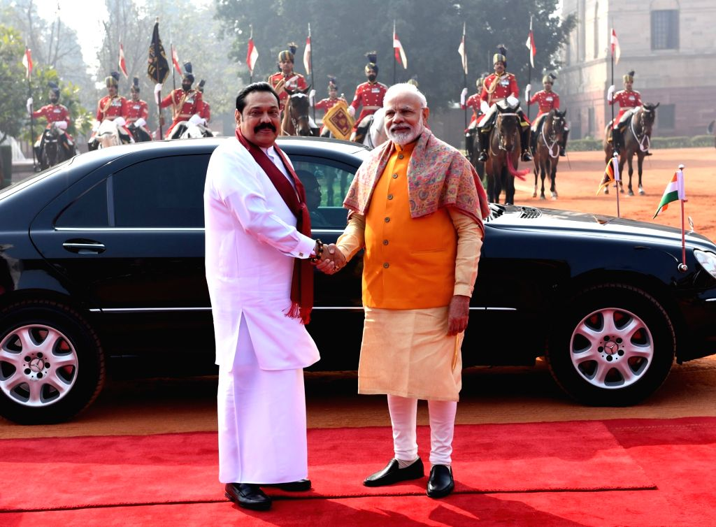 Prime Minister Narendra Modi welcomes his Sri Lankan counterpart Mahinda Rajapaksa during a Ceremonial Reception accorded to the latter at Rashtrapati Bhavan, in New Delhi on Feb 8, 2020. - Narendra Modi