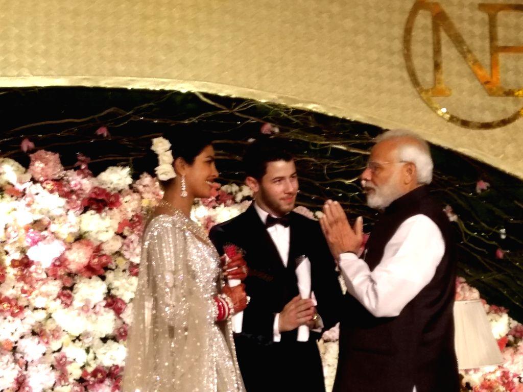 Prime Minister Narendra Modi with actress Priyanka Chopra and Nick Jonas at their wedding reception in New Delhi on Dec 4, 2018. - Narendra Modi and Priyanka Chopra