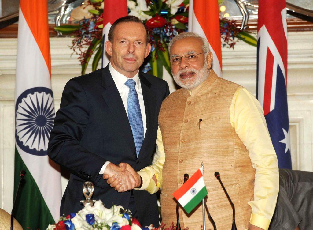 Prime Minister Narendra Modi with Australian Prime Minister Tony Abbott during a joint press conference in New Delhi on Sept 5, 2014. - Narendra Modi