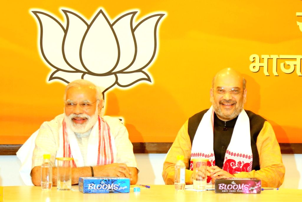 Prime Minister Narendra Modi with BJP chief Amit Shah during BJP Parliamentary Board Meeting in New Delhi, on May 19, 2016. - Narendra Modi and Amit Shah