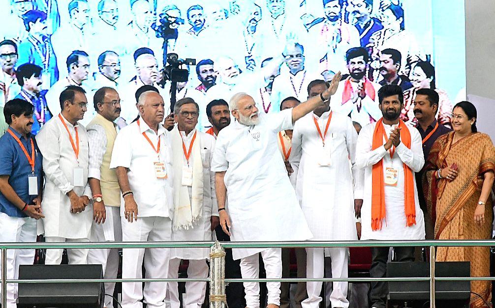 Prime Minister Narendra Modi with BJP leaders B.S. Yeddyurappa and S.M.Krishna during a public rally in Mysuru, Karnataka on April 9, 2019. - Narendra Modi