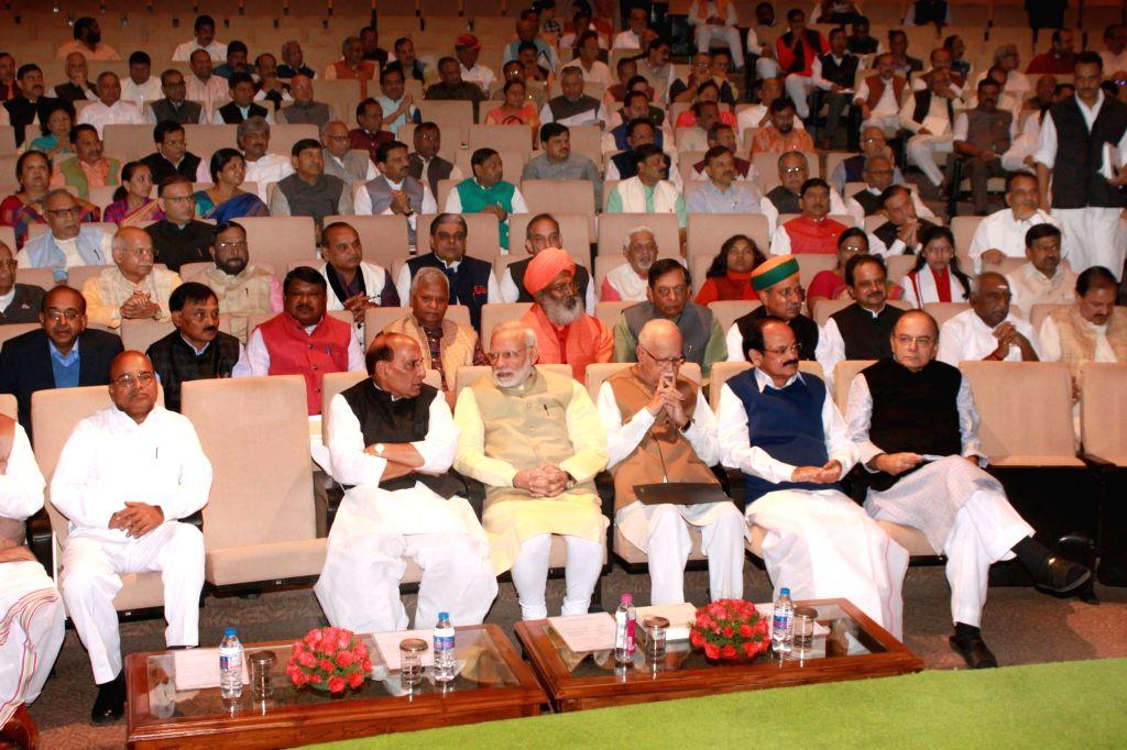 Prime Minister Narendra Modi with BJP leaders LK Advani, Union Finance Minister Arun Jaitley, Union Home Minister Rajnath Singh, Union Minister for Urban Development, Housing & Urban ... - Narendra Modi, M Venkaiah Naidu, Arun Jaitley and Rajnath Singh