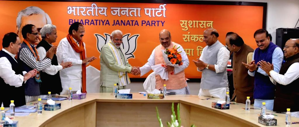 Prime Minister Narendra Modi with BJP president Amit Shah and other senior leaders at BJP Parliament Board Meeting in New Delhi on March 12, 2017. - Narendra Modi and Amit Shah