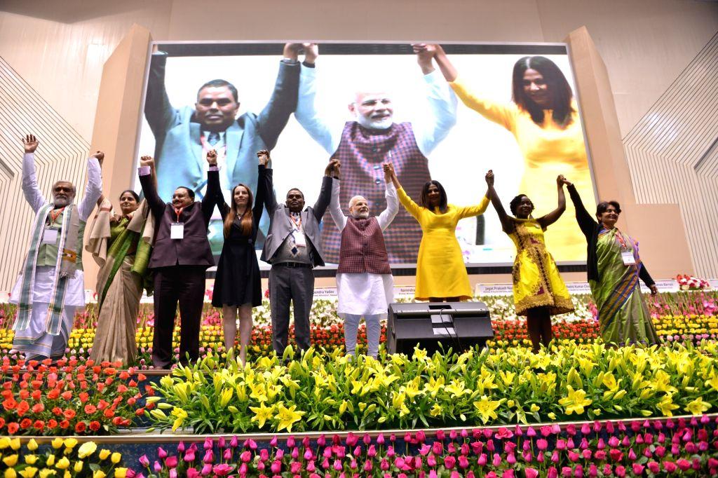 Prime Minister Narendra Modi with dignitaries at the inauguration of the Partners' Forum-2018 in New Delhi on Dec. 12, 2018. (PHoto: IANS) - Narendra Modi