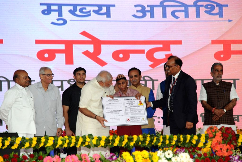 Prime Minister Narendra Modi with Divyang at Samajik Adhikarita Shivir in Navsari, Gujarat on Sept 17, 2016. Also seen Gujarat Governor OP Kohli and Chief Minister Vijay Rupani. - Narendra Modi
