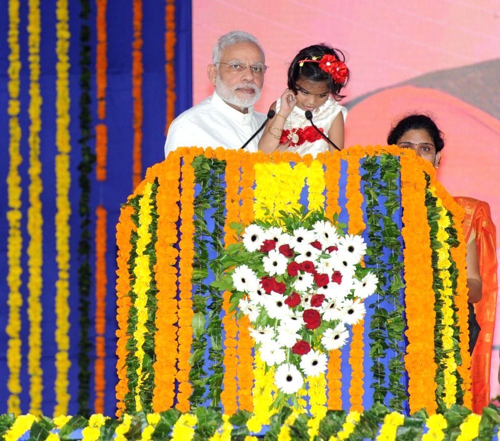 Prime Minister Narendra Modi with Divyang at Samajik Adhikarita Shivir in Navsari, Gujarat on Sept 17, 2016. - Narendra Modi