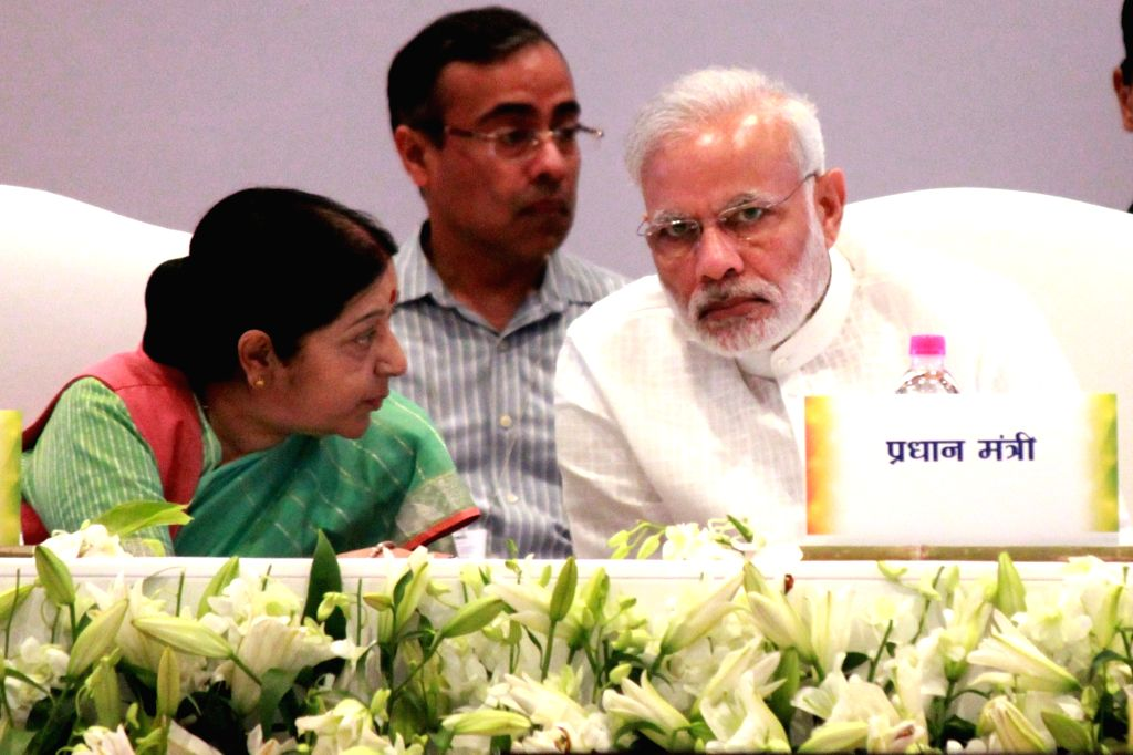 Prime Minister Narendra Modi with External Affairs Minister Sushma Swaraj during inauguration of  Pravasi Bharatiya Kendra in New Delhi, on Oct 2, 2016. - Narendra Modi and Sushma Swaraj