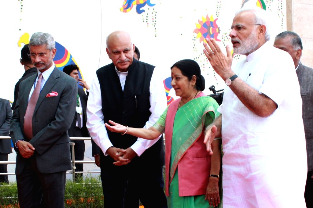 Prime Minister Narendra Modi with External Affairs Minister Sushma Swaraj, Ministers of state for External Affairs VK Singh and MJ Akbar during inauguration of  Pravasi Bharatiya Kendra in ... - Narendra Modi and Sushma Swaraj