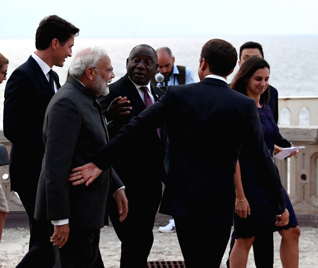 Prime Minister Narendra Modi with French President Emmanuel Macron, Canadian Prime Minister Justin Trudeau and South African President Cyril Ramaphosa at the G7 Summit in Biarritz, France ... - Narendra Modi