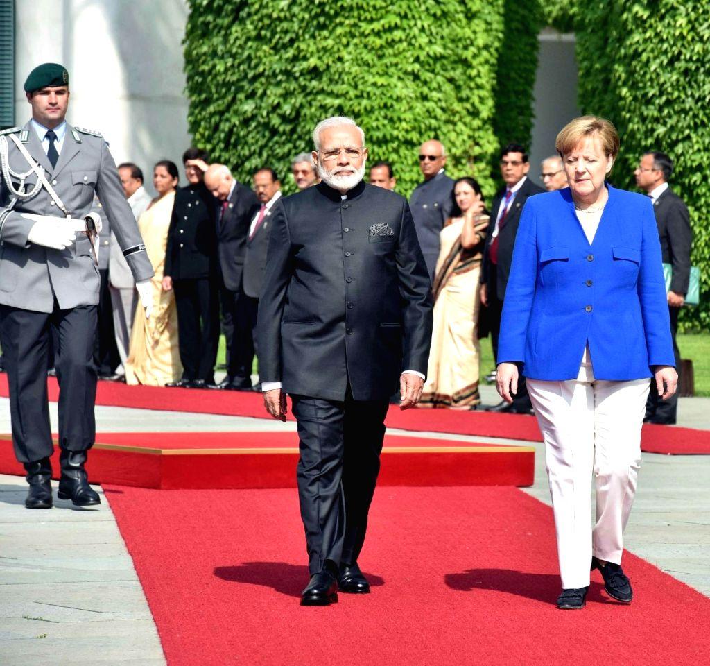 Prime Minister Narendra Modi with German Chancellor, Dr. Angela Merkelduring a ceremonial reception organised for himat German Chancellery in Berlin,Germany on May 30, 2017. - Narendra Modi