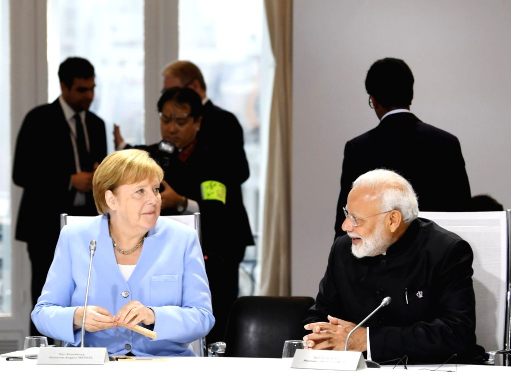 Prime Minister Narendra Modi with German Chancellor Angela Merkel during the session on 'Biodiversity, Oceans, Climate' at the G7 Summit in Biarritz, France on Aug 26, 2019. - Narendra Modi