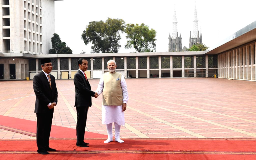 Prime Minister Narendra Modi with Indonesian President Joko Widodo during his visit to Istiqlal Mosque, in Jakarta, Indonesia on May 30, 2018. - Narendra Modi