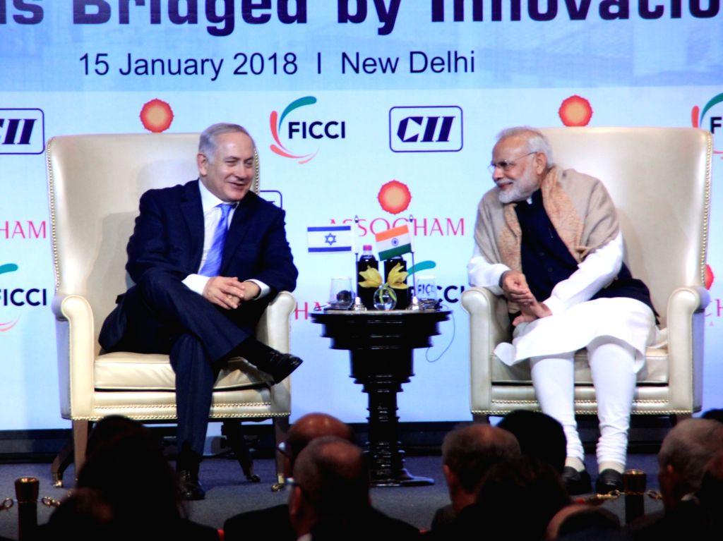 Prime Minister Narendra Modi with Israeli Prime Minister Benjamin Netanyahu during India Israel Business Summit in New Delhi, on Jan 15, 2018. - Narendra Modi