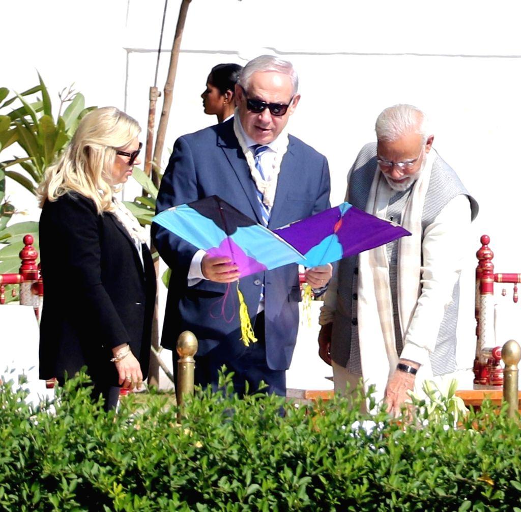 Prime Minister Narendra Modi with Israeli Prime Minister Benjamin Netanyahu and his wife Sara Netanyahu during their visit to Sabarmati Ashram in Ahmedabad on Jan 17, 2018. - Narendra Modi