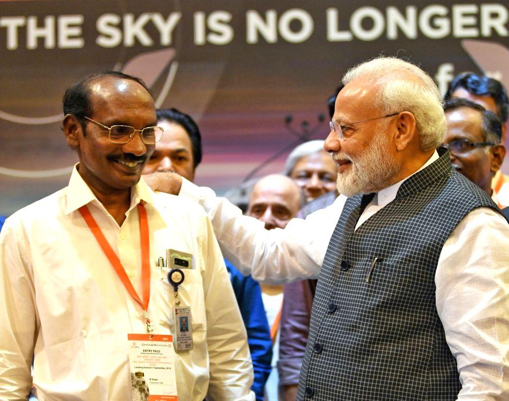 Prime Minister Narendra Modi with ISRO Chairman K. Sivan at the ISRO Headquarters in Bengaluru on Sep 7, 2019. - Narendra Modi