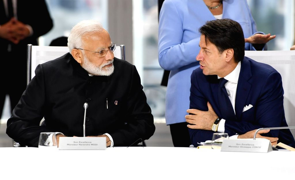 Prime Minister Narendra Modi with Italian Prime Minister Giuseppe Conte during the session on 'Biodiversity, Oceans, Climate' at the G7 Summit in Biarritz, France on Aug 26, 2019. - Narendra Modi
