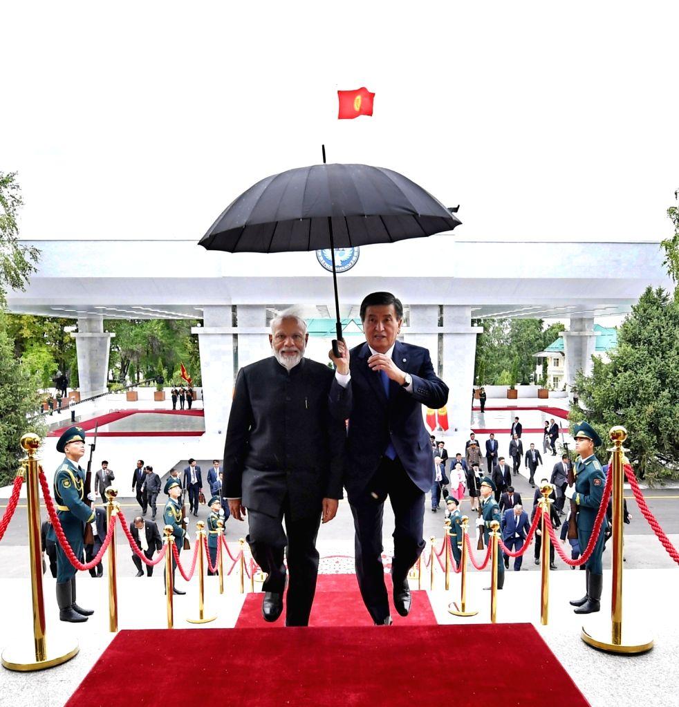 Prime Minister Narendra Modi with Kyrgyzstan President Sooronbay Jeenbekov in Bishkek, Kyrgyzstan on June 14, 2019. - Narendra Modi