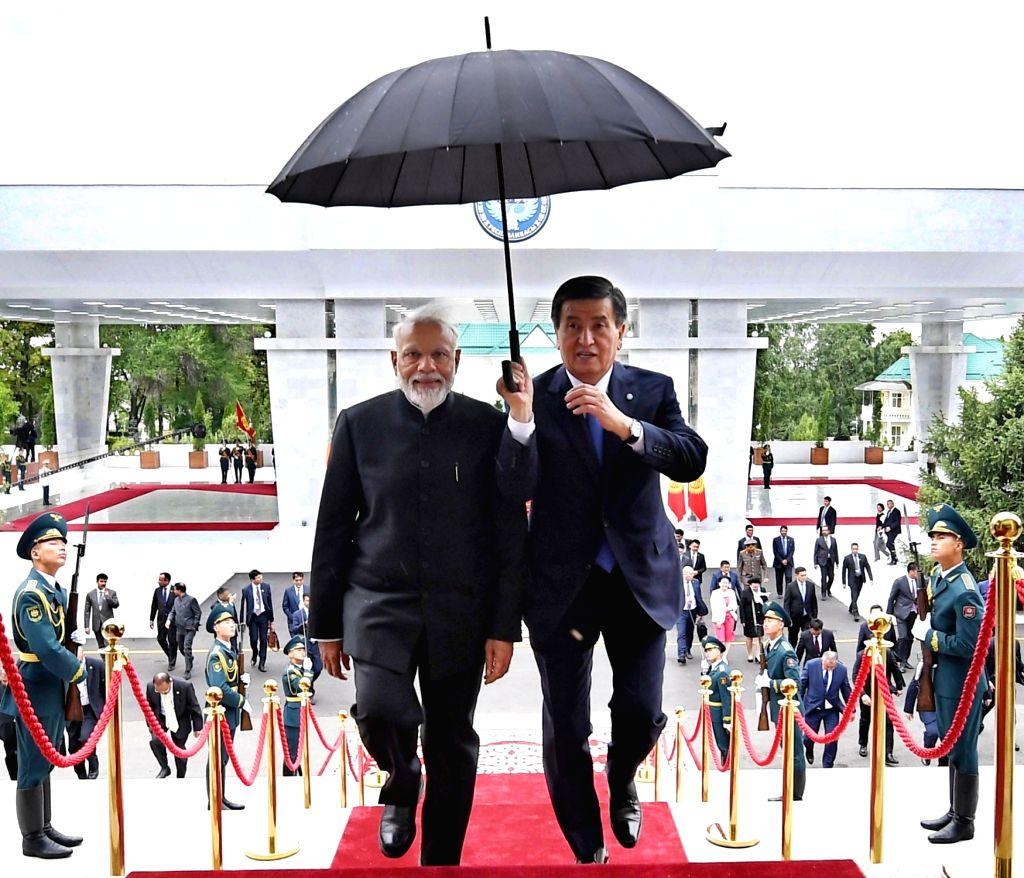 Prime Minister Narendra Modi with Kyrgyzstan President Sooronbay Jeenbekov in Bishkek, Kyrgyzstan on June 14, 2019. (File Photo: IANS/PIB) - Narendra Modi