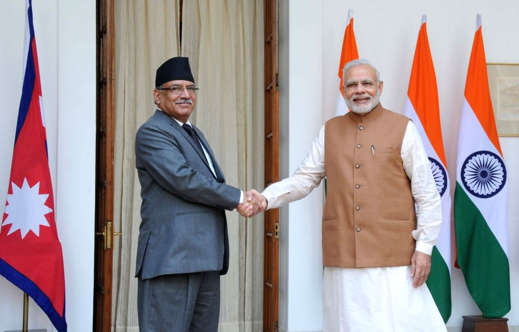Prime Minister Narendra Modi with Nepalese Prime Minister Pushpa Kamal Dahal during a meeting at Hyderabad House, in New Delhi on Sept 16, 2016. - Narendra Modi