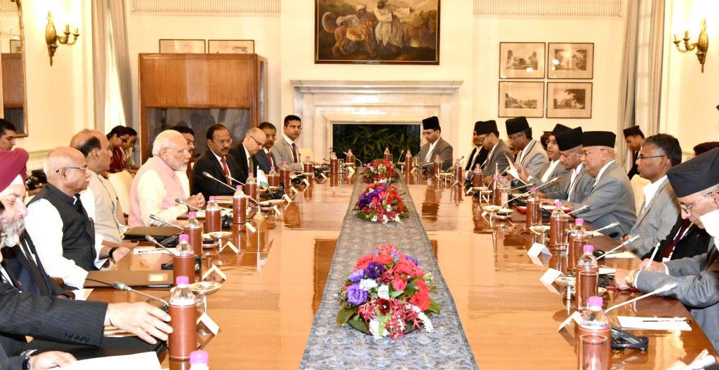 Prime Minister Narendra Modi with Nepalese Prime Minister K.P. Sharma Oli during delegation level talks at Hyderabad House in New Delhi on April 7, 2018. - Narendra Modi and P. Sharma Oli