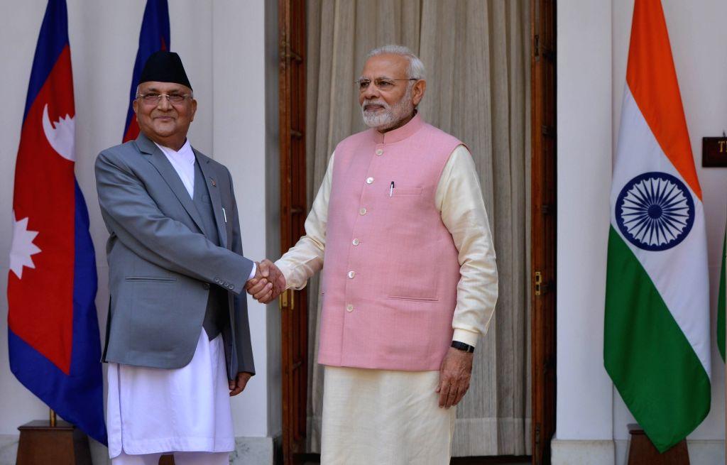 Prime Minister Narendra Modi with Nepalese Prime Minister K.P. Sharma Oli, at Hyderabad House in New Delhi on April 7, 2018. - Narendra Modi and P. Sharma Oli