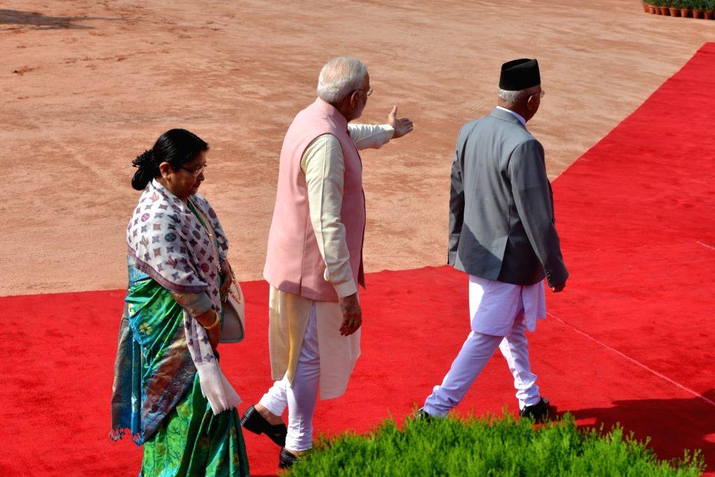 Prime Minister Narendra Modi with Nepalese Prime Minister K.P. Sharma Oli and his wife Radhika Shakya during the Ceremonial Reception, at Rashtrapati Bhavan in New Delhi on April 7, 2018. - Narendra Modi and P. Sharma Oli