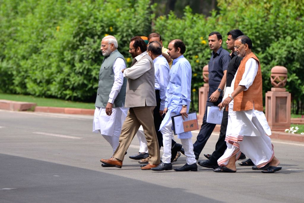 Prime Minister Narendra Modi with other leaders coming out of BJP Parliamentary Party meeting in New Delhi on April 6, 2018. - Narendra Modi