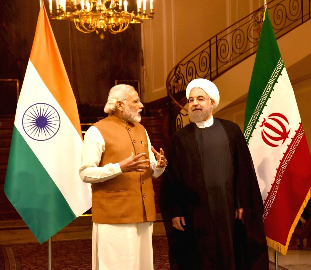 Prime Minister Narendra Modi with President of Iran Hassan Rouhani, in Jomhouri Building, at Saadabad Palace, in Tehran, Iran on May 23, 2016. - Narendra Modi and Hassan Rouhani