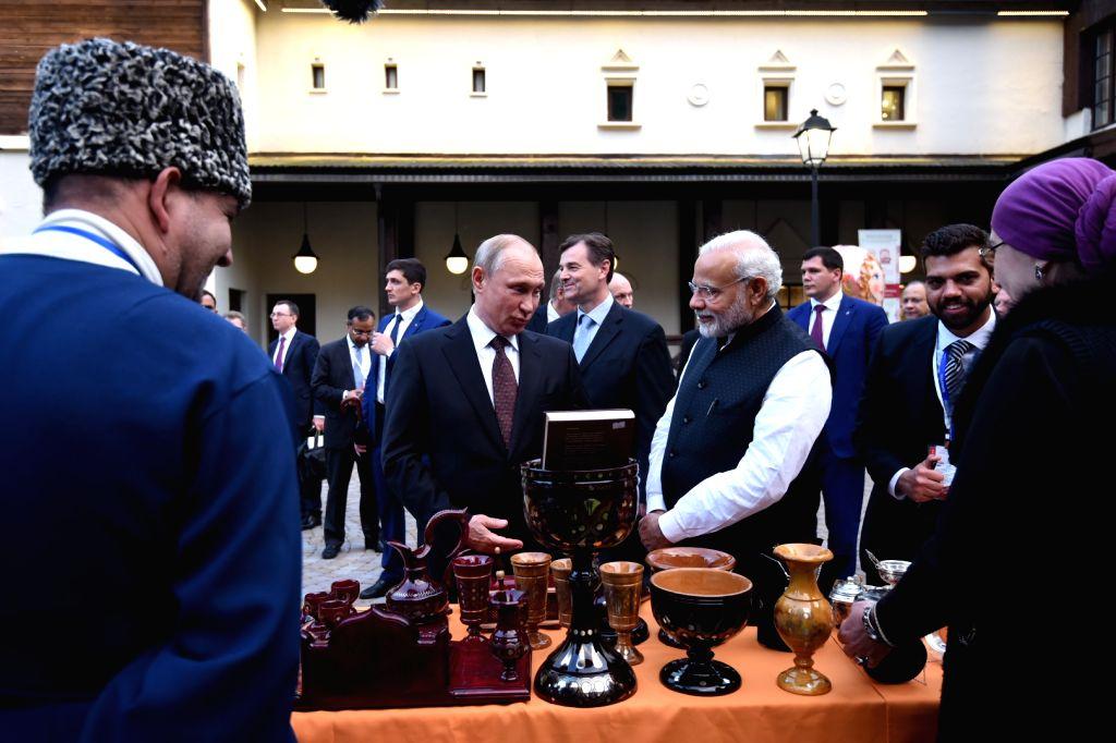 Prime Minister Narendra Modi with Russian President Vladimir Putin, during his visit to Sochi, Russia on May 21, 2018. - Narendra Modi