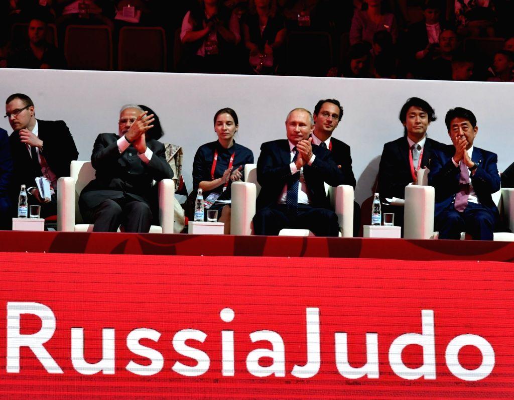 Prime Minister Narendra Modi with Russian President Vladimir Putin and Japanese Prime Minister Shinzo Abe during Fetisov Arena (Judo Tournament) in Vladivostok, Russia on Sep 5, 2019. - Narendra Modi