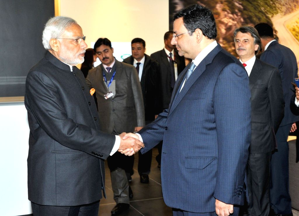 Prime Minister Narendra Modi with Tata group chairman Cyrus Mistry at the Jaguar and Land Rover factory, in Solihull, UK on Nov 14, 2015. - Narendra Modi