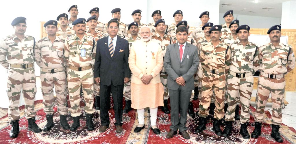 Prime Minister Narendra Modi with the Indian Consulate officials and ITBP Jawans, at Indian Consulate, in Herat, Afghanistan on June 4, 2016. - Narendra Modi