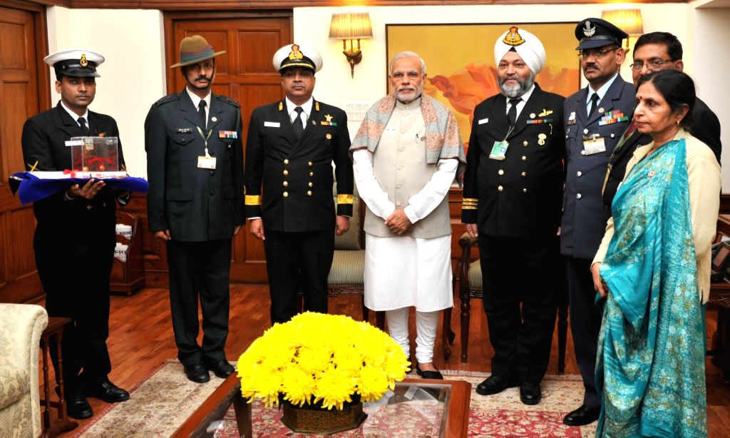 Prime Minister Narendra Modi with the officers of the Kendriya Sainik Board, on the occasion of Armed Forces Flag Day, in New Delhi on Dec 7, 2015. - Narendra Modi