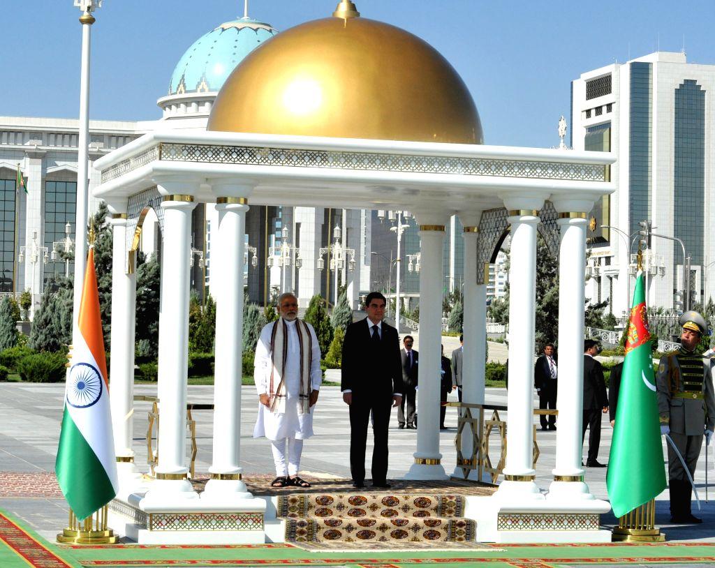 Prime Minister Narendra Modi with the President of Turkmenistan Gurbanguly Berdimuhamedov at the ceremonial welcome, at Independence Square, in Oguzkhan Palace, Ashgabat, Turkmenistan on ... - Narendra Modi