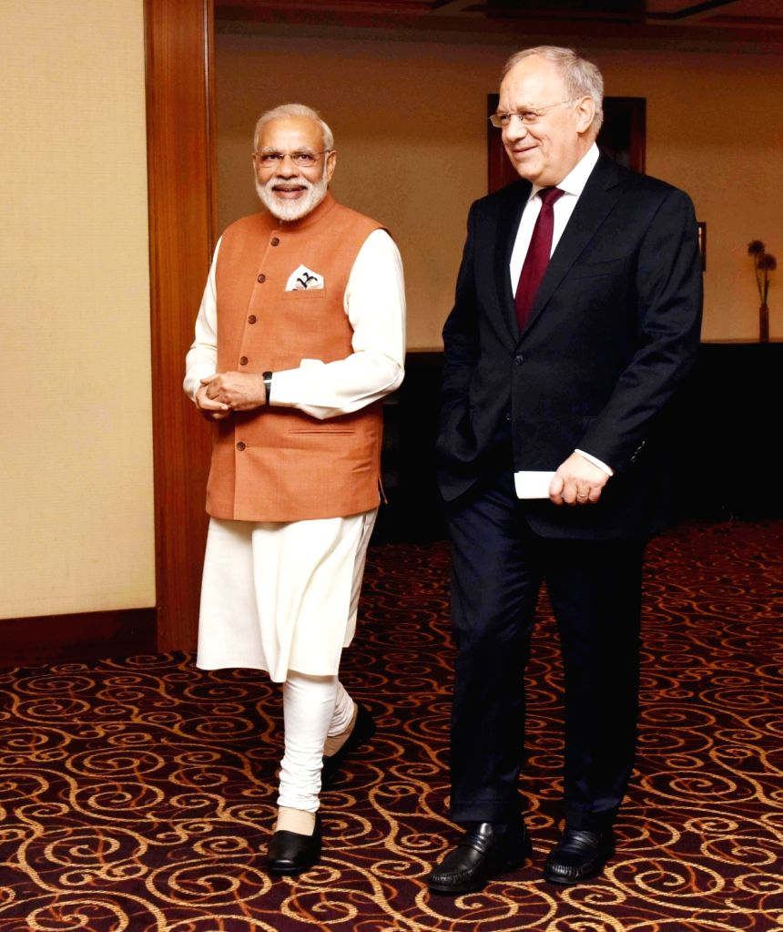 Prime Minister Narendra Modi with the President of the Swiss Federation, Johann Schneider-Ammann, in Geneva on June 6, 2016. - Narendra Modi
