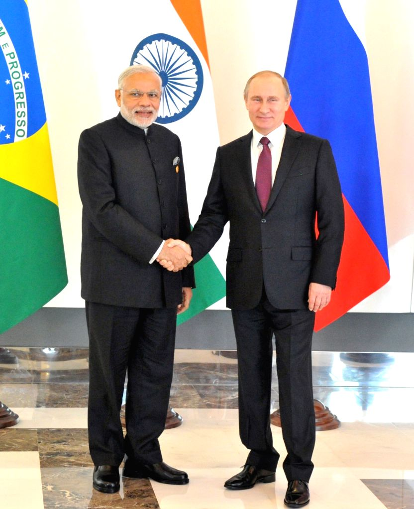 Prime Minister Narendra Modi with the Russian President Vladimir Putin, at the BRICS meeting, on the sidelines of G20 Turkey 2015, in Antalya, Turkey on Nov 15, 2015. - Narendra Modi