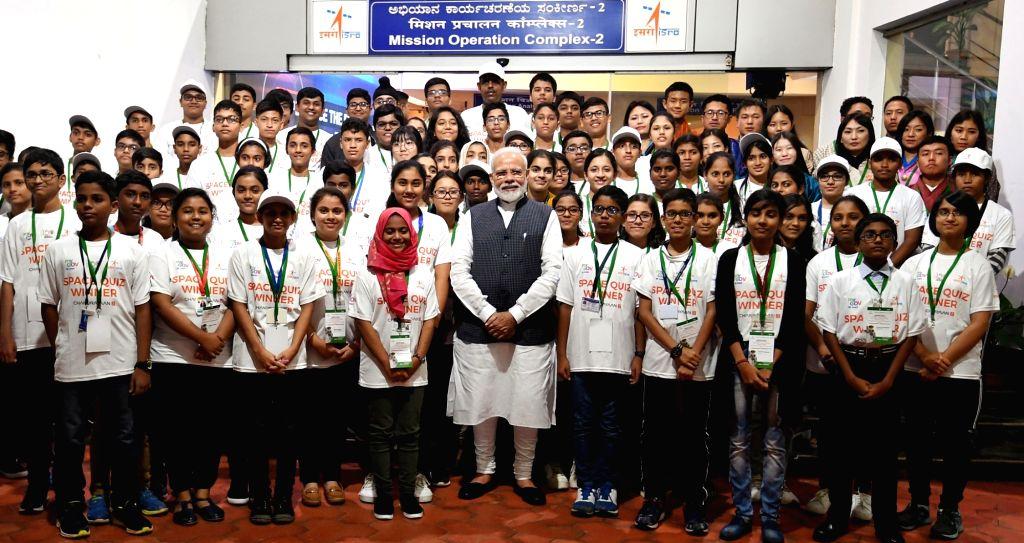 Prime Minister Narendra Modi with the winners of Space Quiz  at the ISRO Headquarters in Bengaluru on Sep 7, 2019. - Narendra Modi