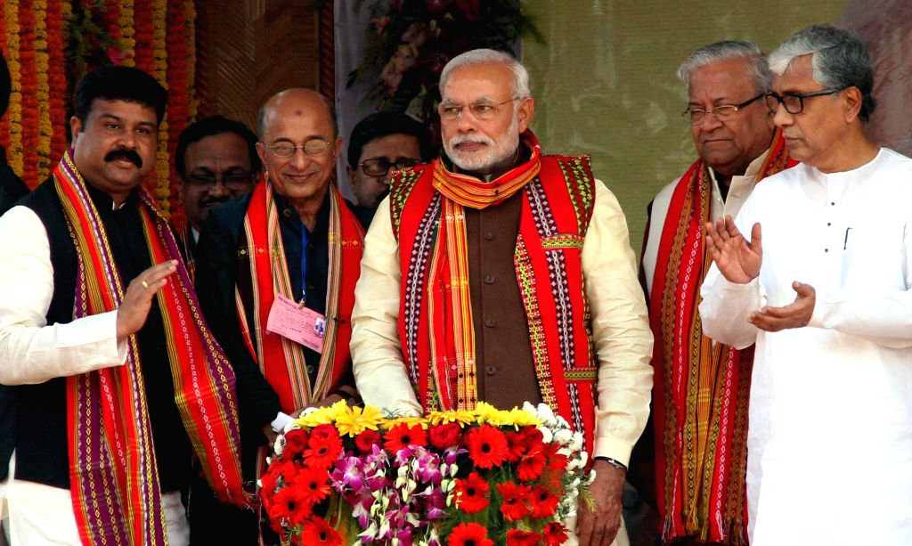 Prime Minister Narendra Modi with Tripura Chief Minister Manik Sarkar at the inauguration of 726 MW gas based thermal power project at Palatana in Gomati district of Tripura on Dec 1, 2014. - Narendra Modi