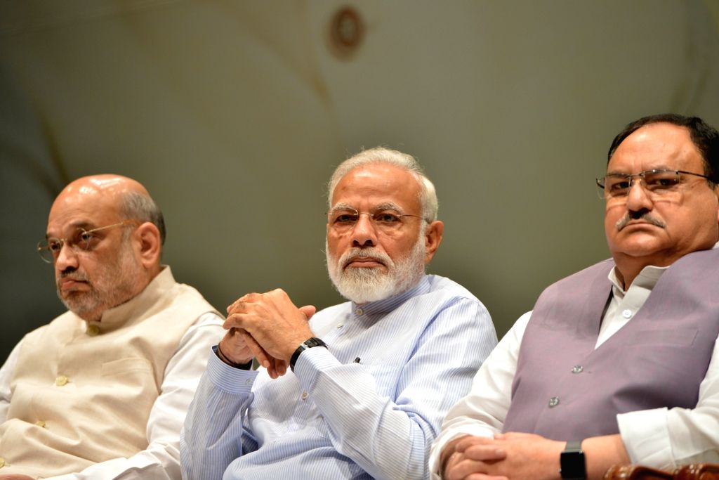 Prime Minister Narendra Modi with Union Home Minister Amit Shah and BJP Working President J.P. Nadda during the two-day compulsory orientation programme 'Abhyas Varga' organised for all ... - Narendra Modi and Amit Shah