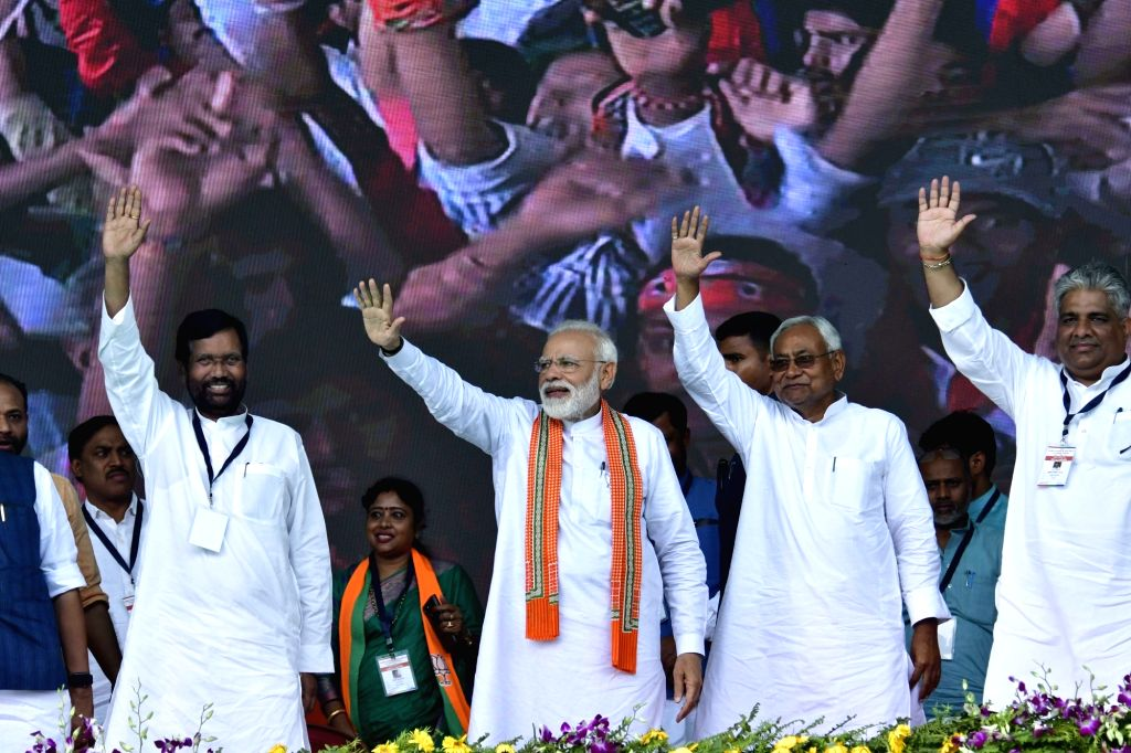 Prime Minister Narendra Modi with Union Minister Ram Vilas Paswan, Bihar Chief Minister Nitish Kumar and BJP leader Bhupender Yadav during a public rally in Bihar's Bhagalpur on April 11, ... - Narendra Modi, Nitish Kumar and Bhupender Yadav