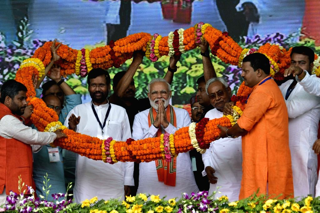 Prime Minister Narendra Modi with Union Minister Ram Vilas Paswan and Bihar Chief Minister Nitish Kumar during a public rally in Bihar's Bhagalpur on April 11, 2019. - Narendra Modi and Nitish Kumar
