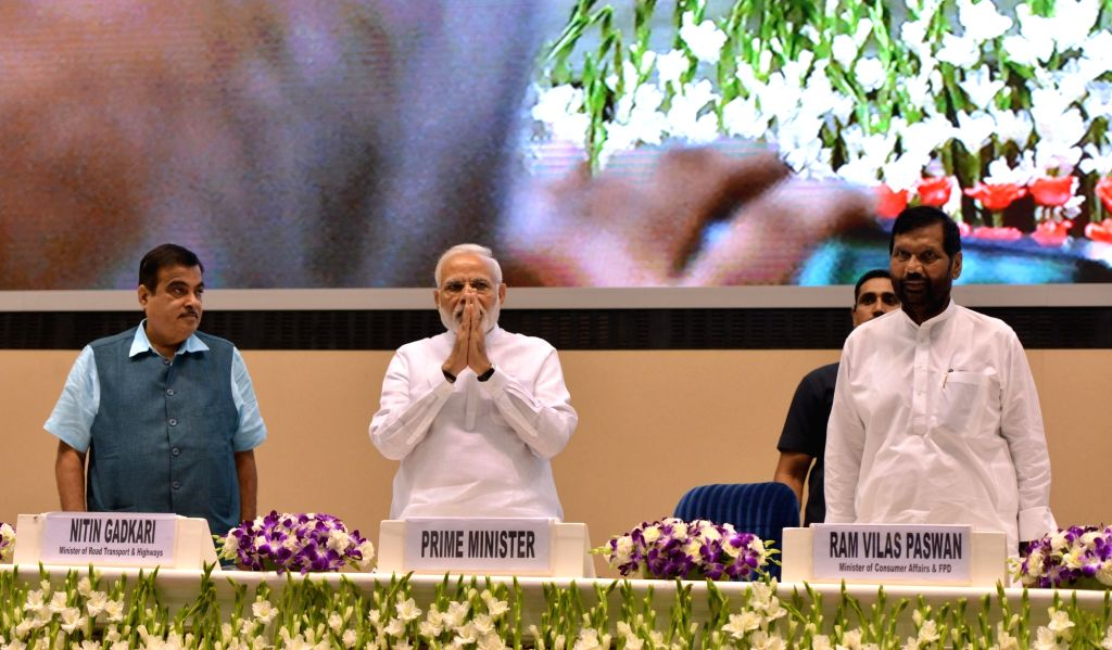 """Prime Minister Narendra Modi with Union Ministers Nitin Gadkari, and Ram Vilas Paswan, at the inaugural programme of the """"World Biofuel Day 2018"""", in New Delhi, on Aug 10, 2018. - Narendra Modi and Nitin Gadkari"""